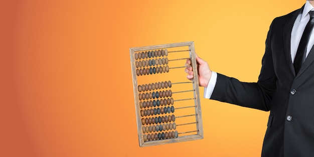 Unrecognizable businessman showing you a vintage abacus. business concept