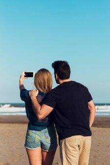 Unrecognizable couple posing for selfie