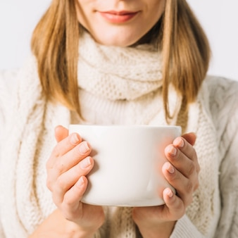Unrecognizable female with hot drink