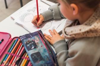 Unrecognizable kid coloring picture