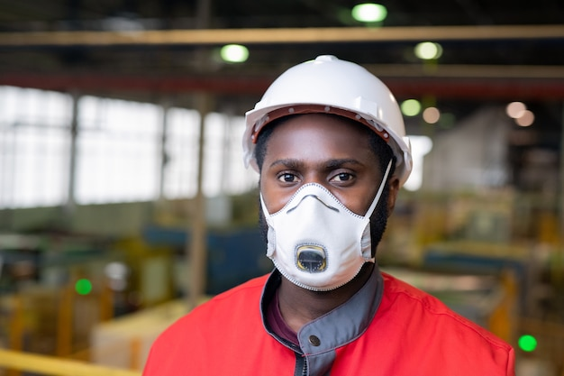 Unrecognizable male engineer in mask