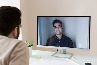 Unrecognizable man having video conversation