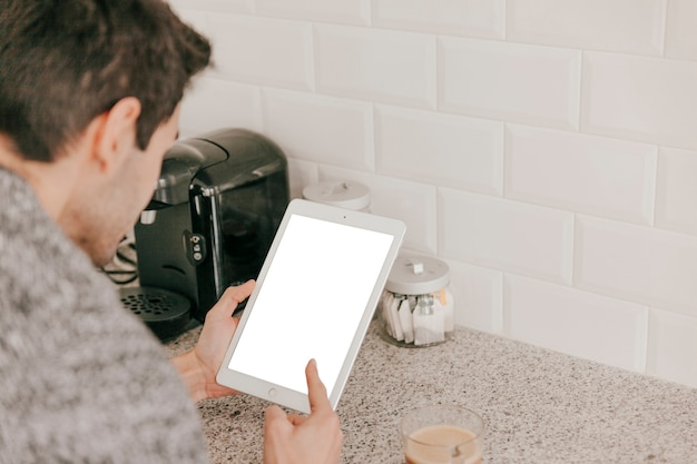 Unrecognizable man pointing at tablet