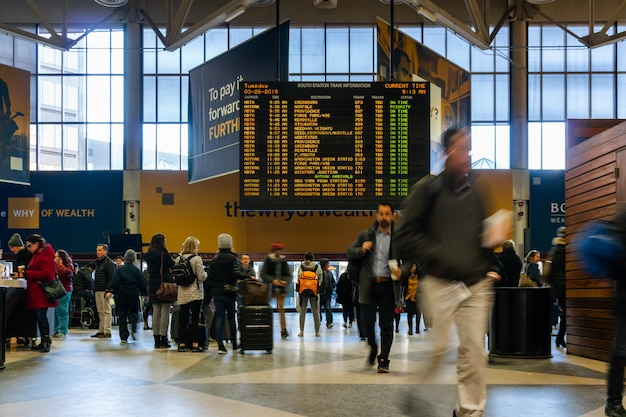 Unrecognizable person and tourist visiting south station looking for train information