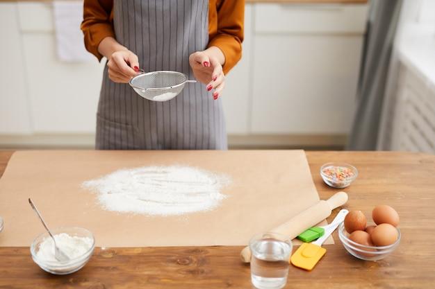 Unrecognizable woman baking