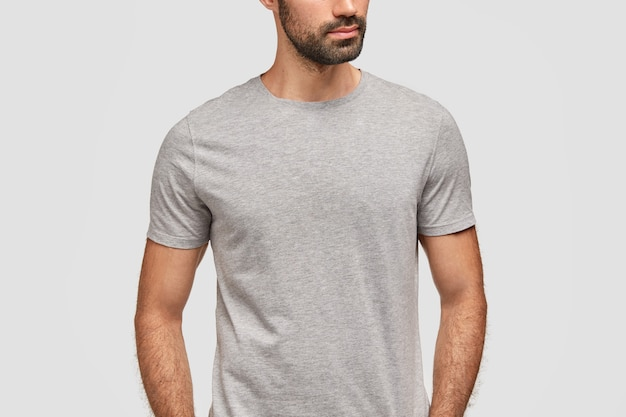 Unrecongnizable bearded man dressed in casual grey t shirt