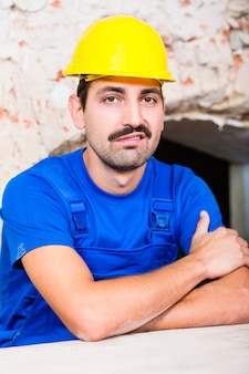 Unsatisfied construction worker on site grunting