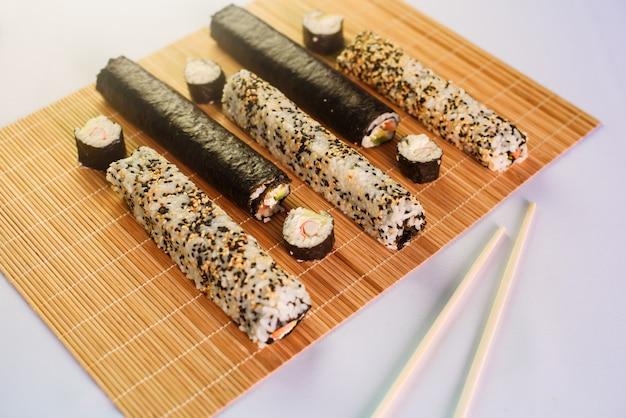 Unsliced sushi maki isolated on white background