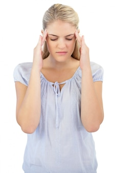 Unsmiling blonde woman has headache