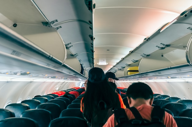 Unspecified passengers were walking out of the plane following the exit sign