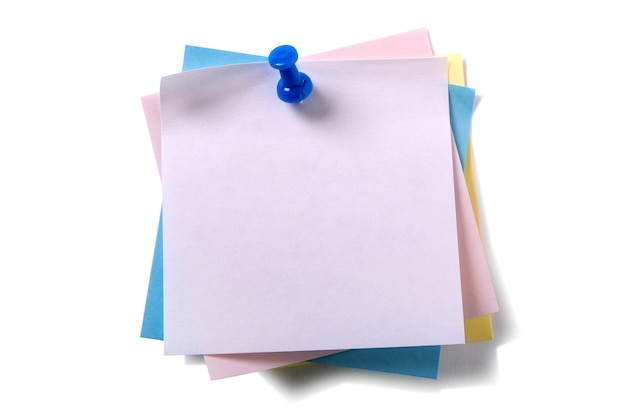 Untidy pile various colors sticky post notes with pushpin isolated on white