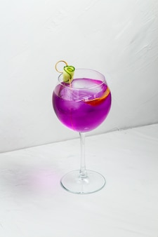 Unusual purple alcoholic cocktail in a wine glass