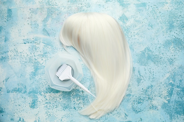 Unusual wig with supplies for hair dyeing on color