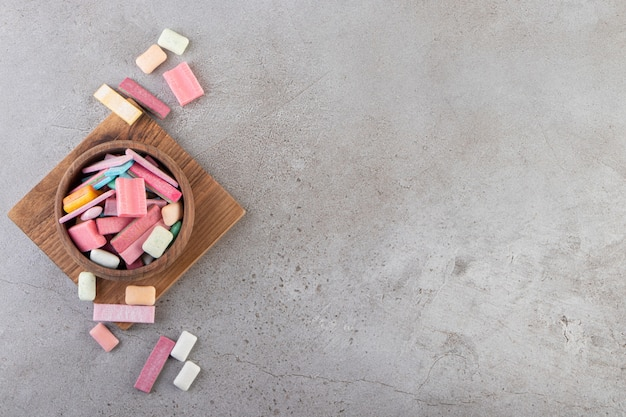 Unwrapped sugar free chewing gum sticks placed in a bowl.