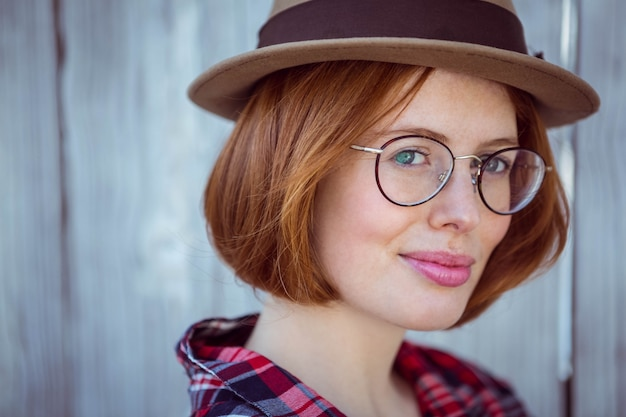 Up close portrait of a smiling hipster woman,