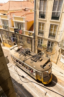 Up view of tram on narrow european street