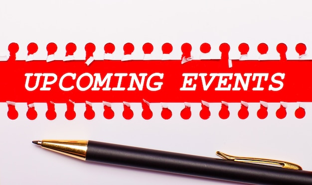 Upcoming events written on white paper on a light brown background.