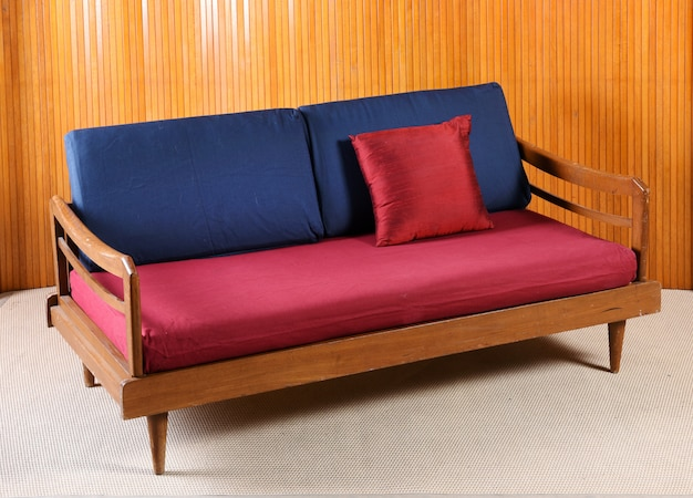 Upholstered red and blue vintage sofa