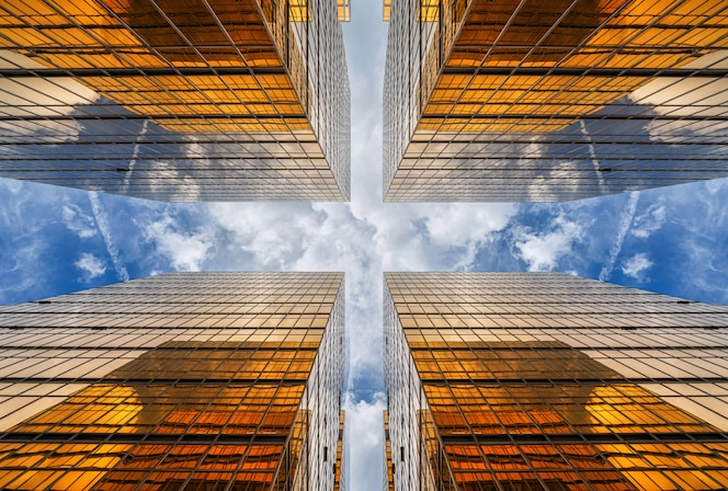 Uprisen angle of Hong Kong skyscraper with reflection of clouds among high building, Building glasses