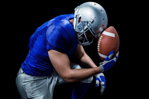 Upset american football player with ball