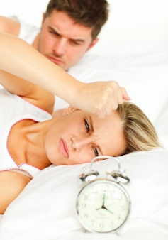 Upset couple lying on their bed