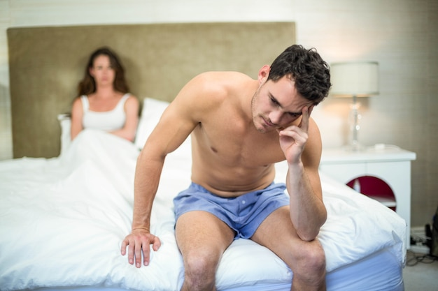 Upset couple sitting on after having an argument