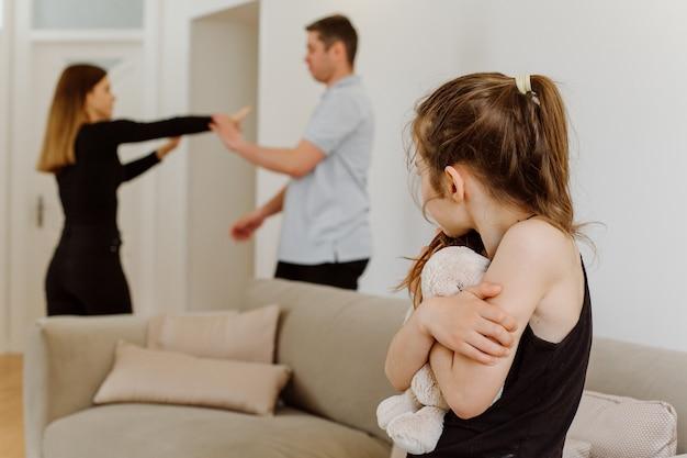 Upset daughter feels sad of parents fighting quarreling