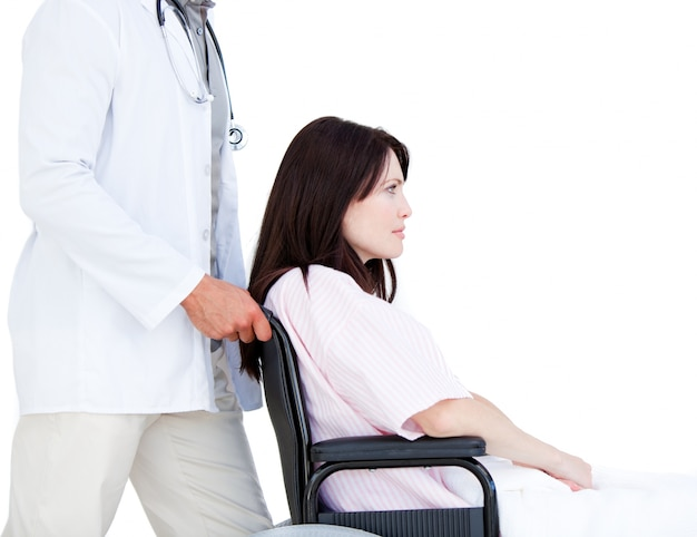 Upset female patient in a wheelchair with her doctor