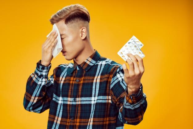 Upset guy with napkins in hands pills health