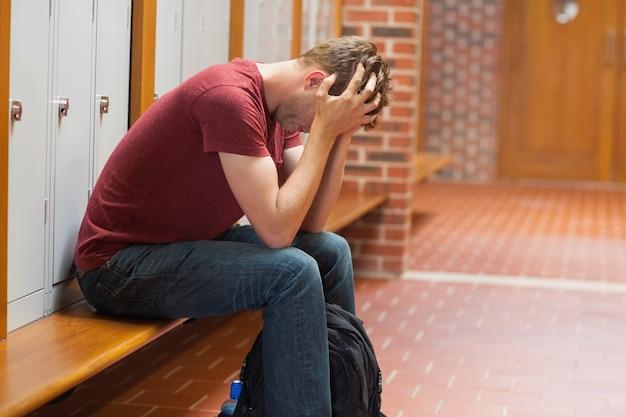 Upset handsome student having a headache