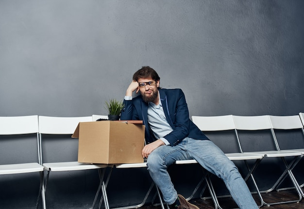 Upset male manager box with things career dismissal