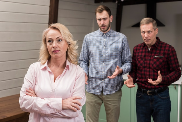 Upset mother looking away from family