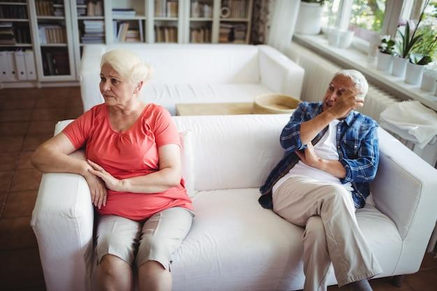 Upset senior couple ignoring each other