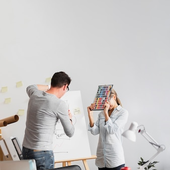Upset woman and man working on company problems