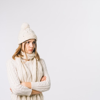 Upset woman in warm clothes