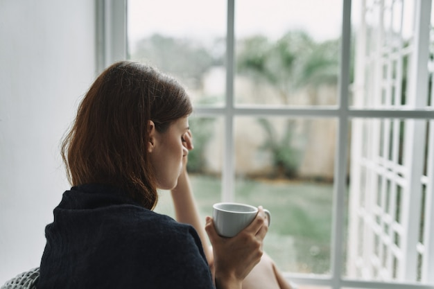 Upset woman with a cup of coffee in the morning