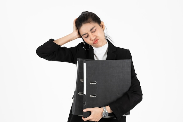 Upset young asian business woman in suit suffering from severe depression