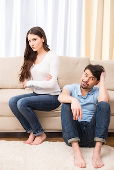 Upset young couple are having marital problems.
