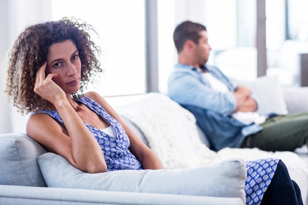 Upset young couple ignoring each other