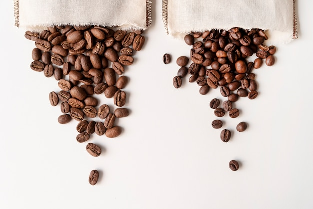 Upside down coffee beans in burlap bags