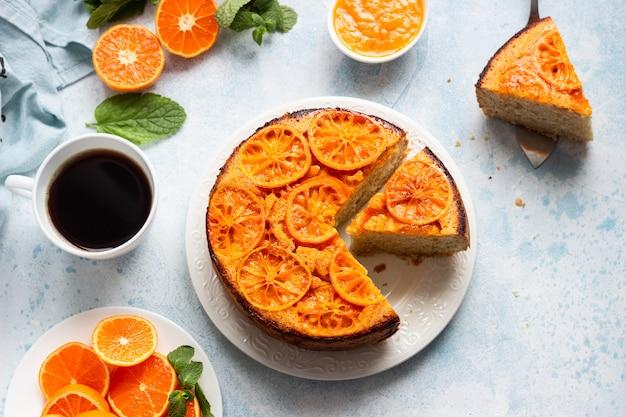 Upside down tangerine cake on a sky-blue stone .