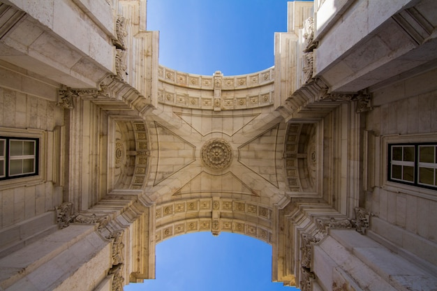 Upward view of the famous arch of the augusta street located in lisbon, portugal.