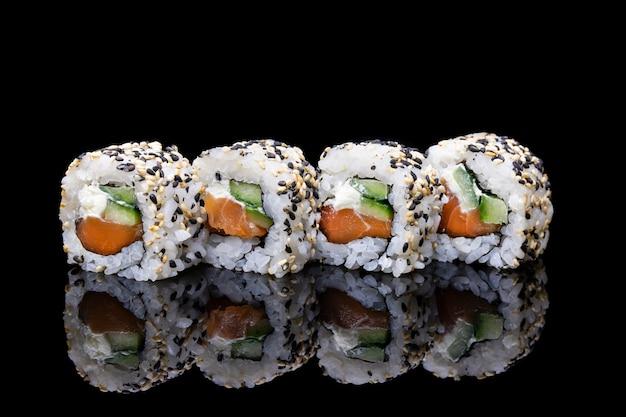 Uramaki philadelphia sushi with salmon cucumbers and sesame