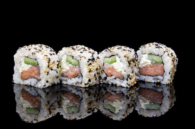 Uramaki philadelphia sushi with smoked salmon cucumbers and sesame
