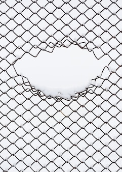 Urban abstraction with geometric pattern. fence made of metal wire. winter background for design with copy space