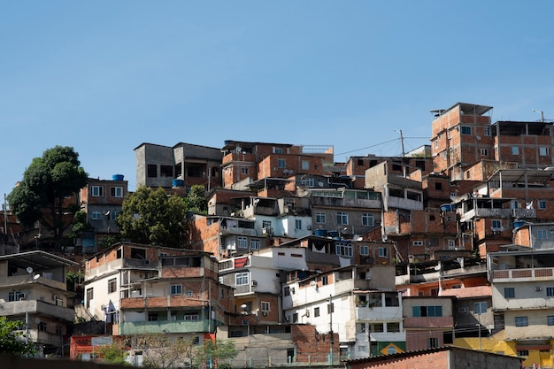 Urban area with slums, simple buildings usually built on the hillsides of the city sky