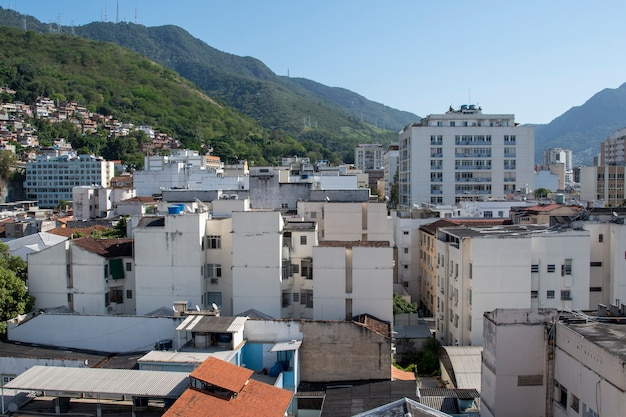 Urban area with slums, simple buildings usually built on the hillsides of the city