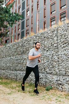 Urban athlete next to stone wall