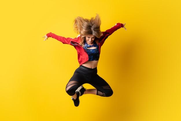 Urban ballerina dancing and jumping