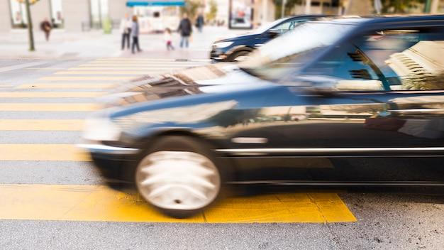 Urban cars on yellow striped printed on asphalt